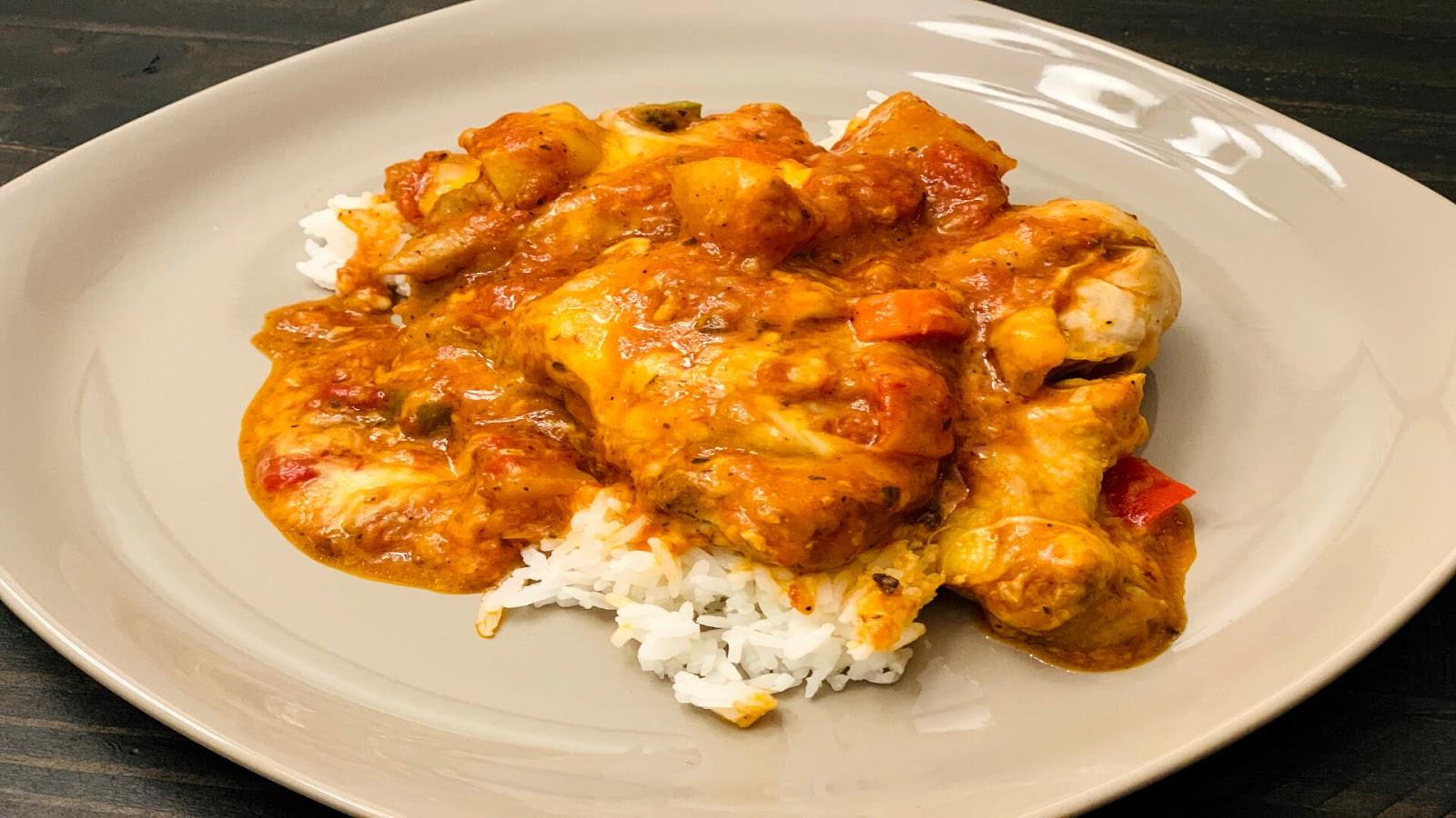 Cheesy Chicken Afritada on plate