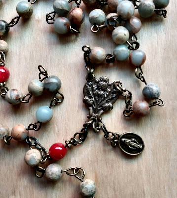 thistle rosary centerpiece with mary medal