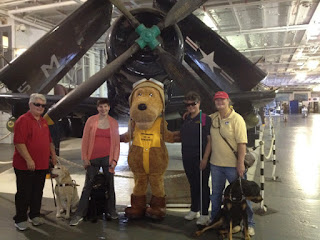 Dixie Landers on Yorktown flight hangar deck with Mascot Scrappy