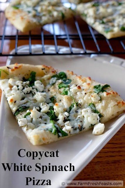 Fresh spinach, feta and mozzarella cheese on a roasted garlic oil-brushed crust. A copycat recipe for a homemade version of CPK White Spinach Pizza.