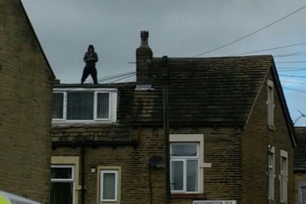 BREAKING Police stand-off with man on roof of house on Westminster Terrace, Undercliffe