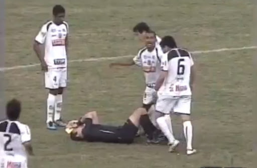 Referee Rodrigo Nunes de Sa tumbles to the ground after a bit of an altercation with a player