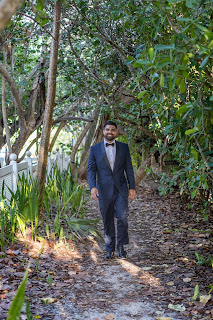 Photograph of groom in navy tux before island ceremony.