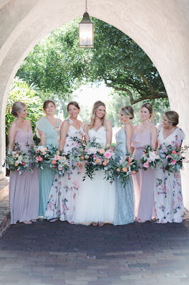 bride and bridesmaids in pastel flower dresses at casa feliz