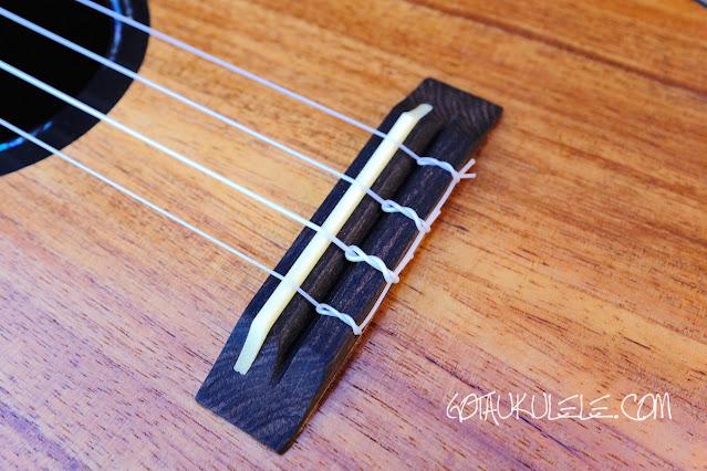 Kumu 4 string tenor ukulele bridge
