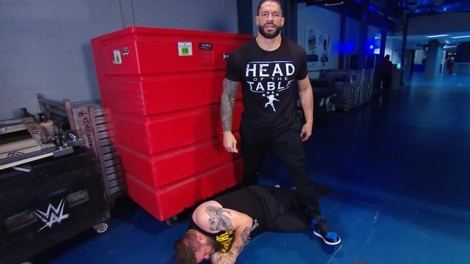 Roman Reigns and Kevin Owens on WWE SmackDown Live