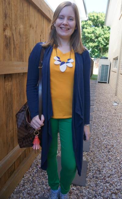navy waterfall cardigan with mustard yellow tee and green skinny jeans statement necklace speedy b bag | awayfromblue