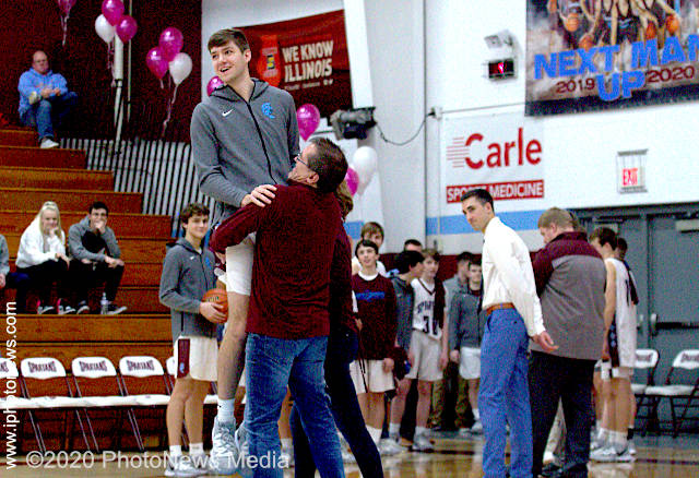 Braydon Rupert gets a big lift from his dad on senior night at SJO