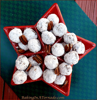 Biscoff Apple Bourbon Balls, a take off on a long time favorite cookie. No bake, quick and easy to make, so much flavor | Recipe developed by www.BakingInATornado.com | #recipe #holiday #cookies
