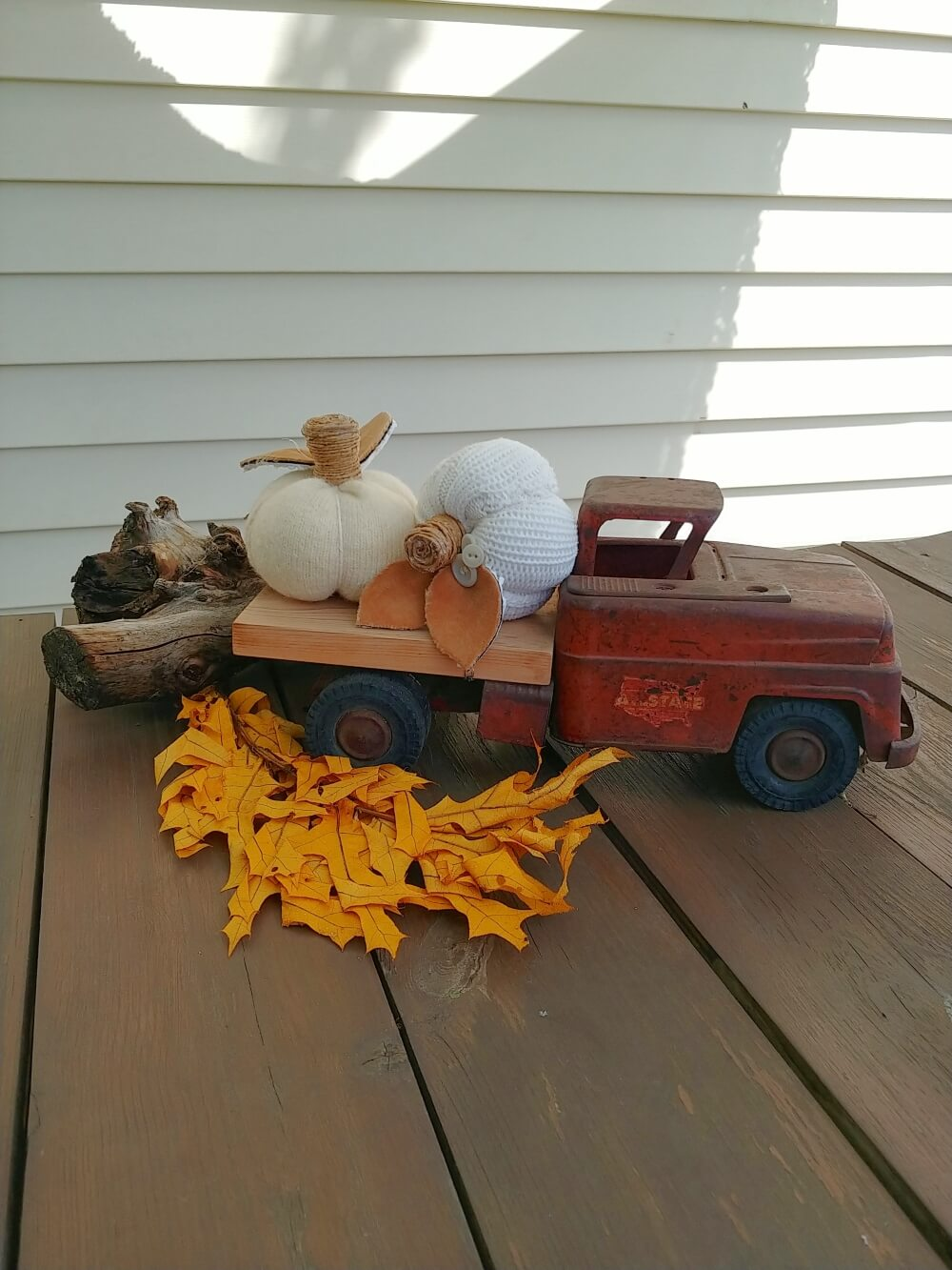 white sweater pumpkins on toy truck