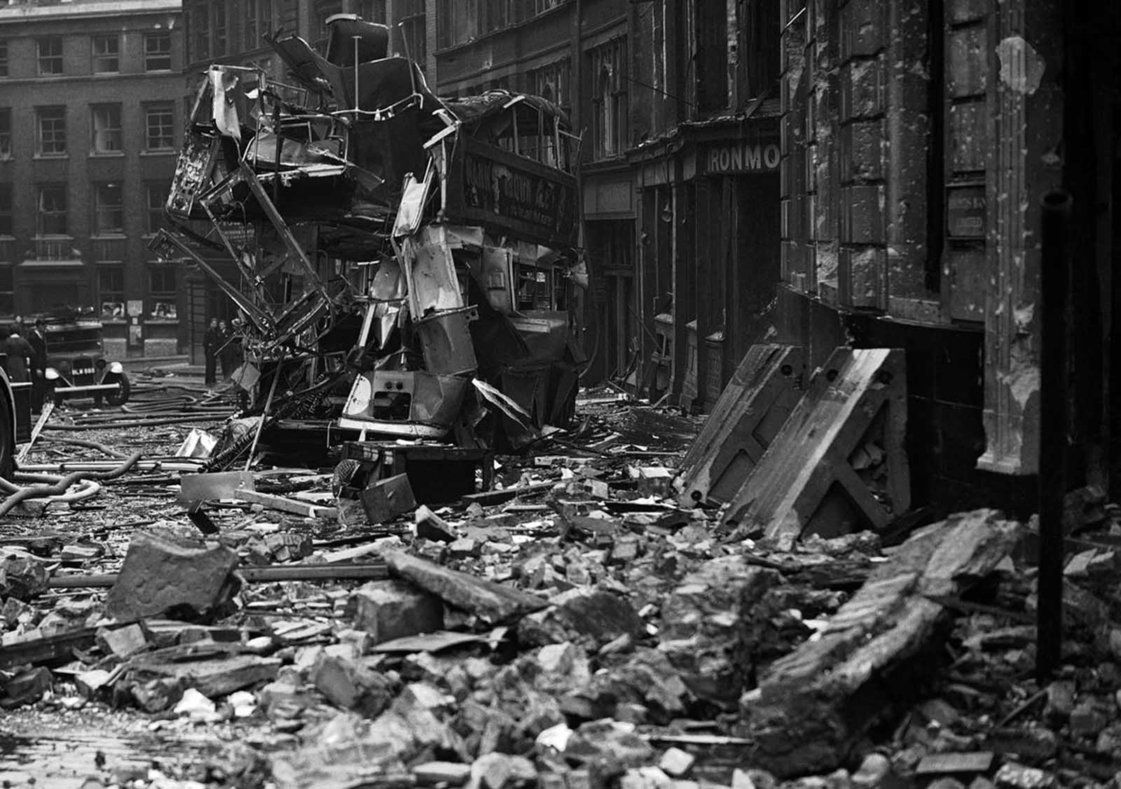 Air raid damage, including the twisted remains of a double-decker city bus, in the City of London on September 10, 1940.