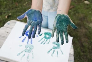 school painting hand prints