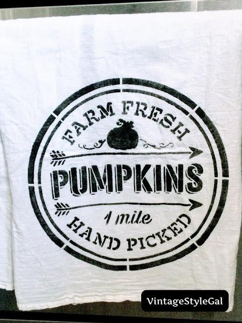 Farm fresh pumpkin tea towel hanging on handle on oven door