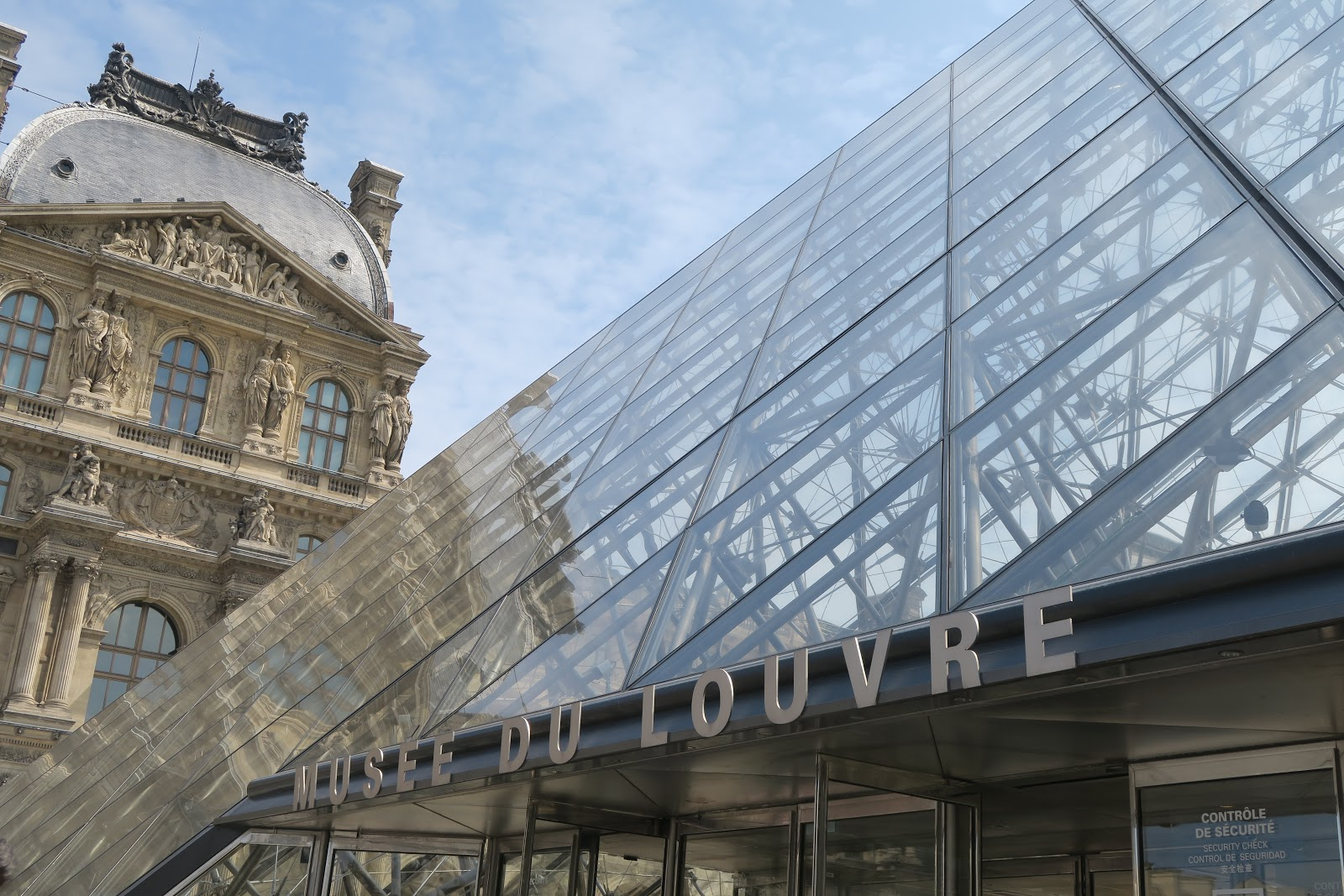 Exterior of the Louvre featuring a glass pyramid