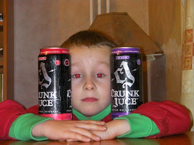 boy with cans of crunk juice or juce, alcoholic energy drink with fruit additives