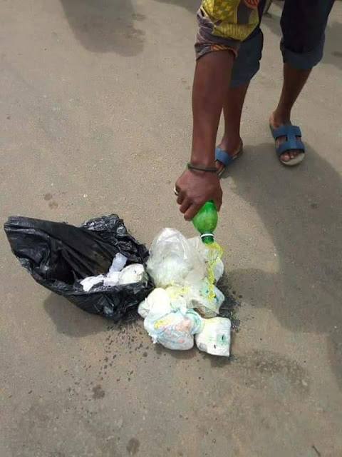 Woman caught picking used sanitary pads and diapers at waste bin in Owerri