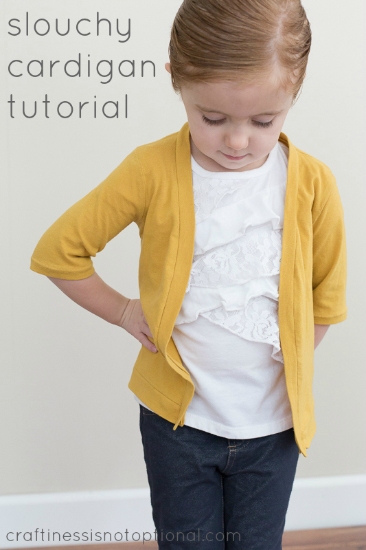 a young girl wears a simple cardigan made from yellow jersey fabric