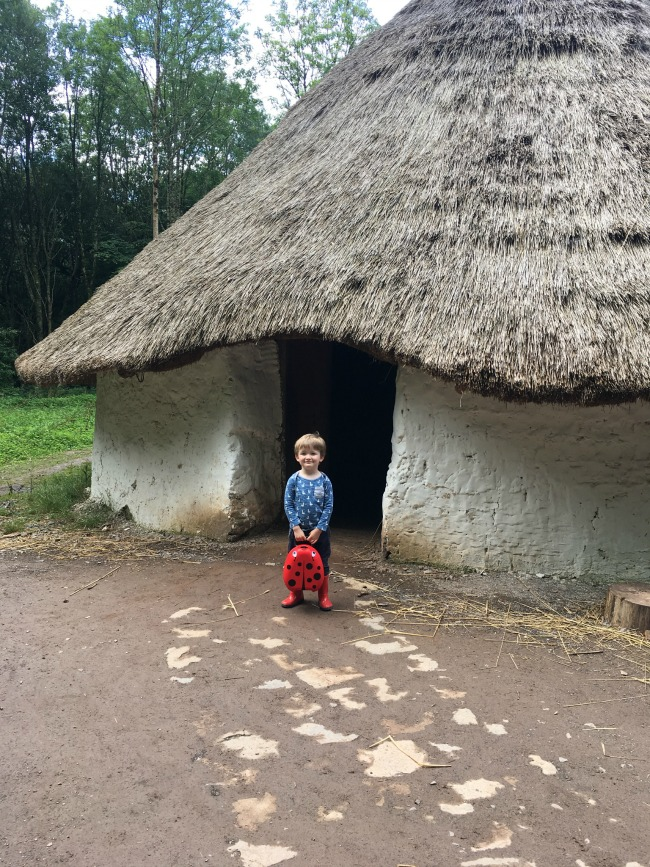 toddler-holding-My-Carry-Potty-from-Cheeky-Rascals-at-st-Fagans-museum-iron-age-roundhouse