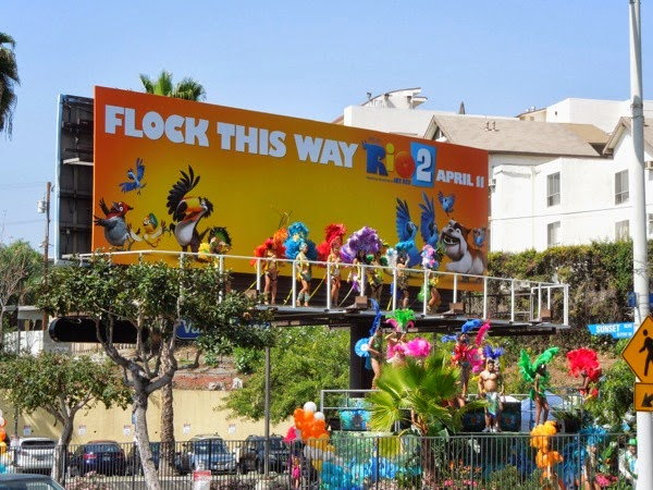 Rio 2 Flock this way carnival dancer billboard installation Sunset Strip