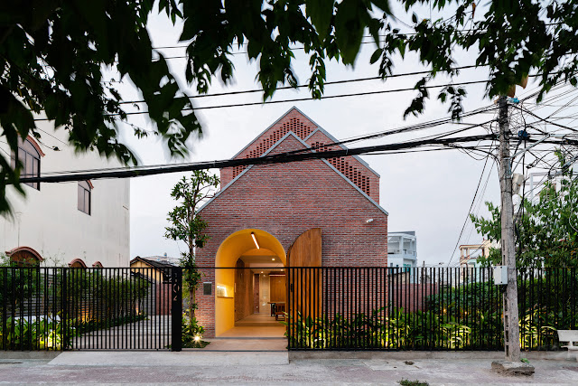 front exterior view of modern brick home in Vietnam with archways