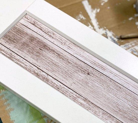 Woodgrain paper in recess of cabinet door