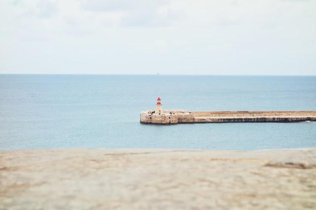 The Malta Firework Festival - Malta beach and lighthouse
