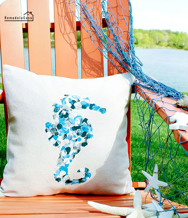 envelope pillow on Adirondack chair by the lake