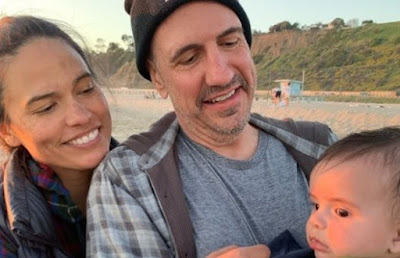 sam lloyd and wife vanessa with their son