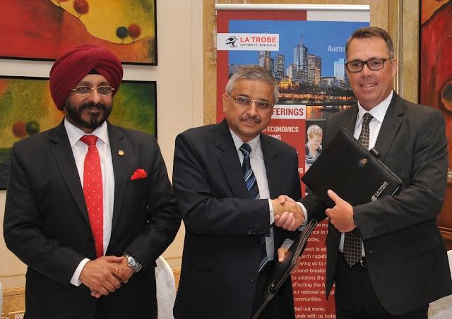 (L to R) Prof. Dr. Gurinder Singh, Group VC, Amity University_ Prof. Randeep Guleria, Director, AIIMS & Prof. John Dewar, VC & President, La Trobe University, Australia signing M