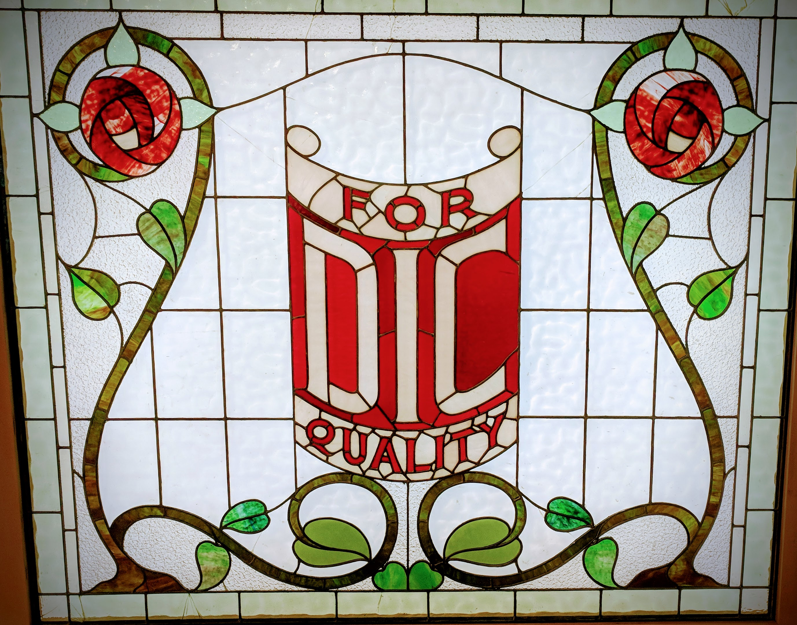 'For DIC Quality', stained glass window
