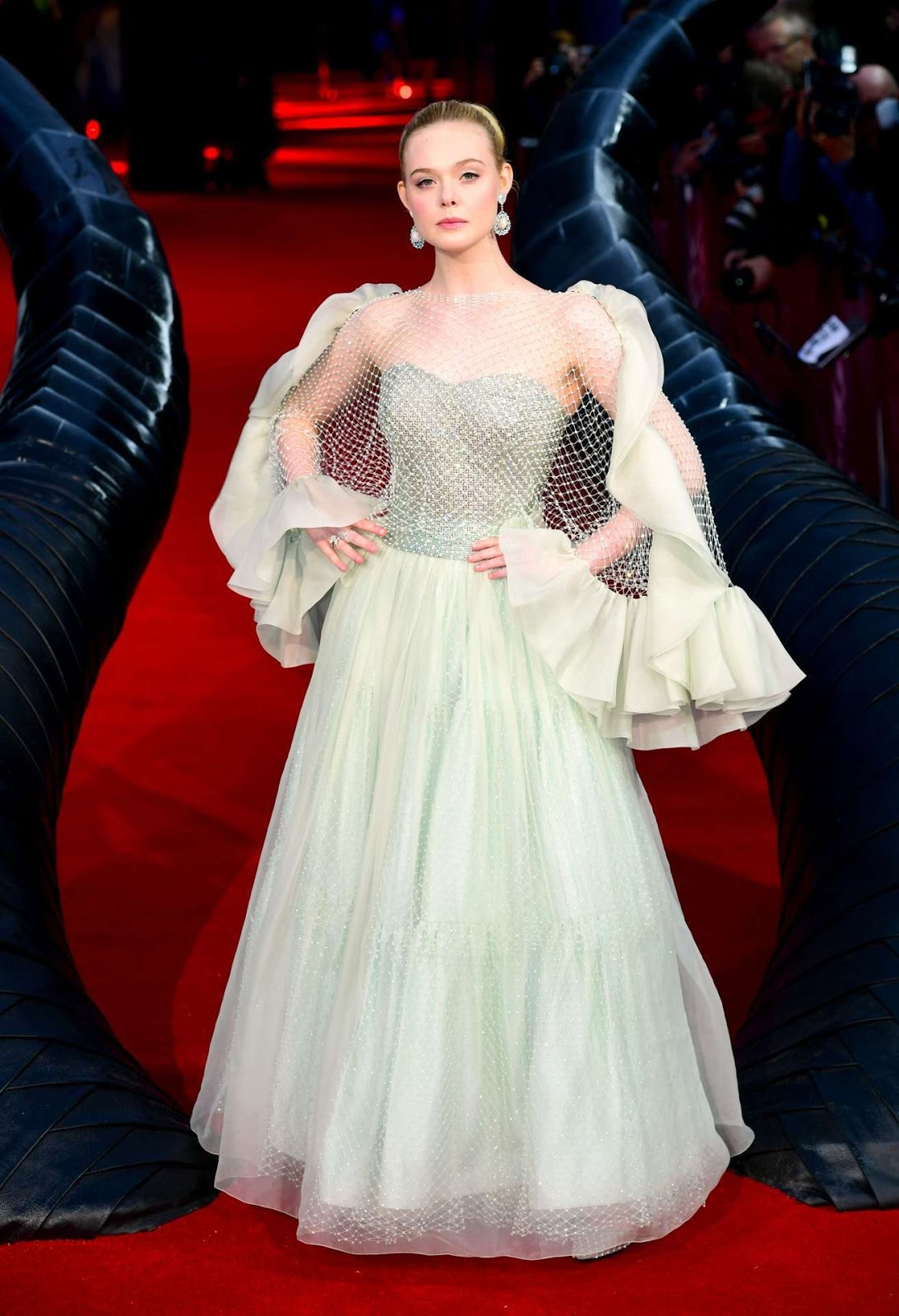 Elle Fanning looks ethereal in a pale green ball gown as she struts down the red carpet at Maleficent: Mistress Of Evil London premiere