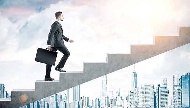 how to be more driven in career goals job growth ambition climb corporate ladder