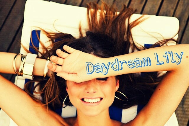 Daydream Lily Girl laying down and smiling