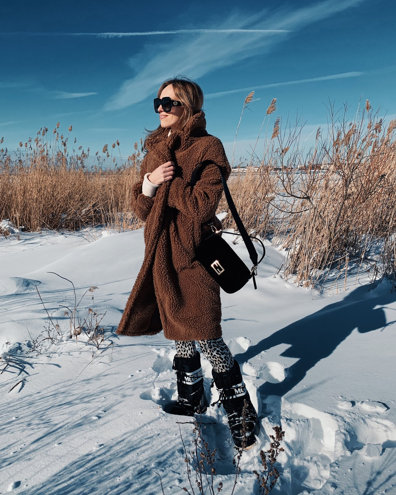 teddy coat moon boots gucci oversized sunglasses fendi baguette bag outfit