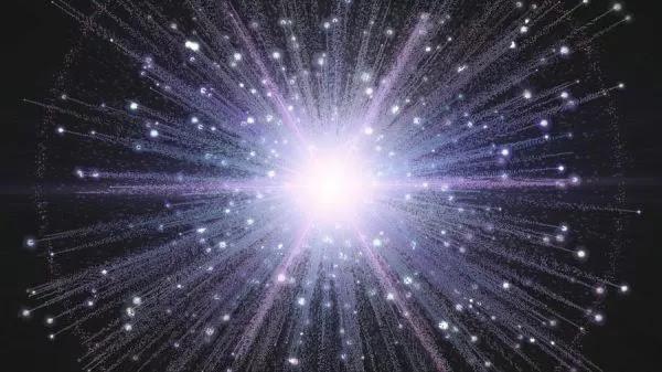 Impressione artistica del Big Bang con particelle che sparano via da un nucleo luminoso.