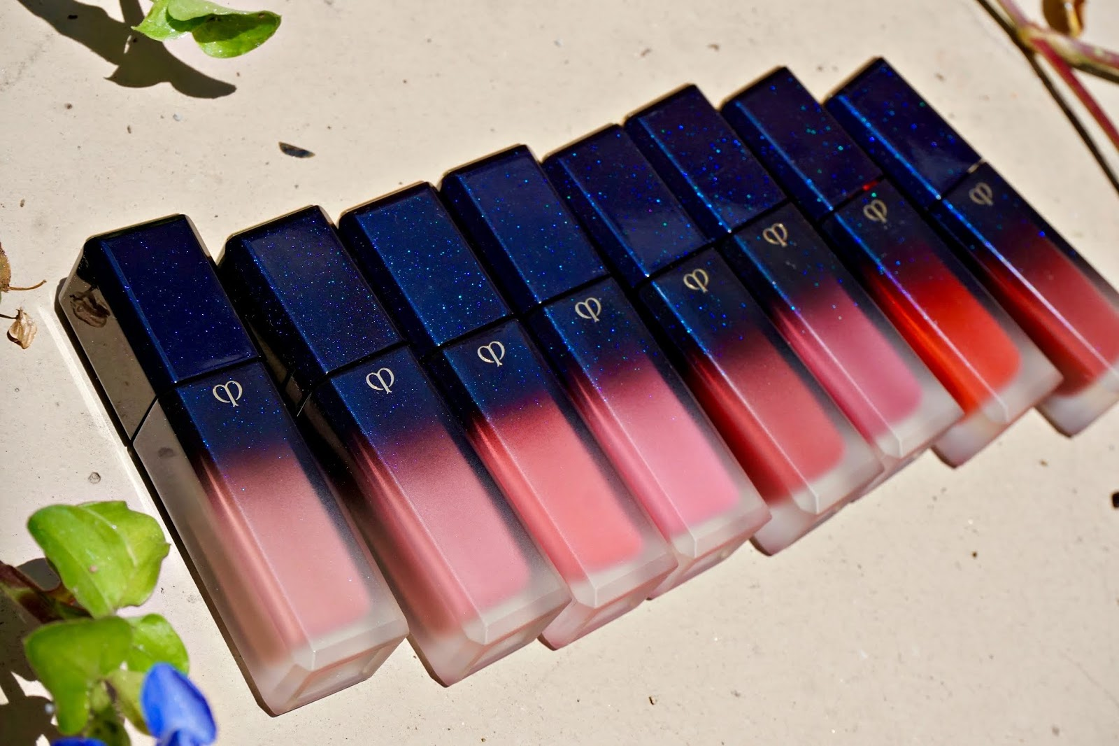 clé de peau radiant liquid rouge matte swatches