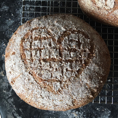 Bread with a heart shaped scoring pattern