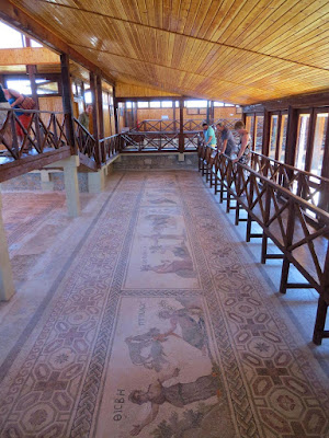 Cyprus Road Trip Itinerary: Mosaics under a canopy at Paphos Archaeological Park