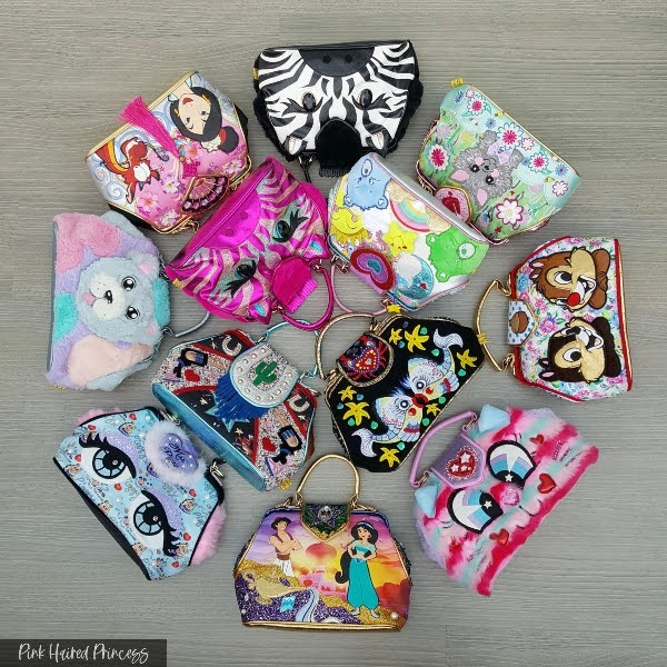 collection of 12 Irregular Choice handbags in circle
