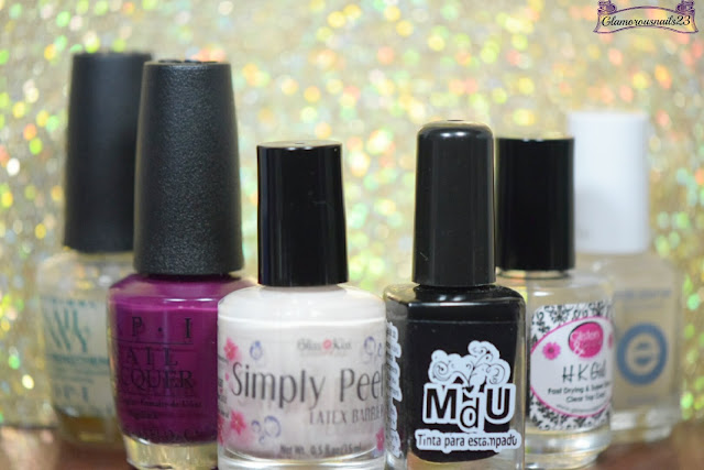 O.P.I Original Nail Envy, O.P.I What's The Hatter With You, Bliss Kiss Simply Peel Latex Barrier, Mundo De Unas Black, Glisten & Glow HK Girl Fast Drying Top Coat, Essie Matte About You
