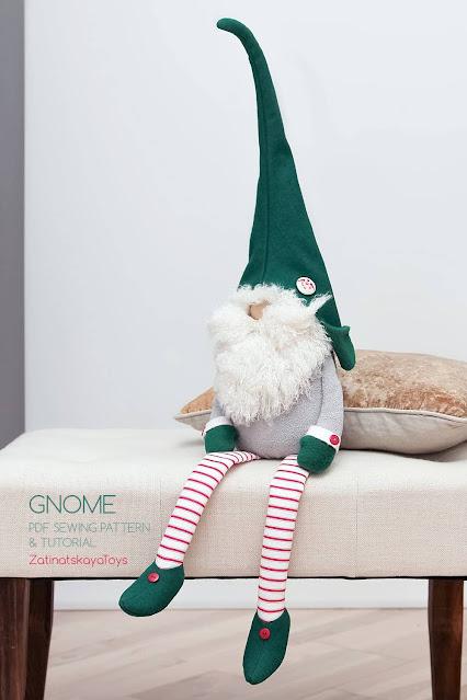 sitting Christmas gnome with a big hat and dangling legs by sewing patterns of Zatinatskaya Natalia