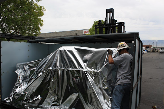 Printing Press Being Unloaded at McNeil Printing