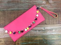 https://shopmmrr.com/collections/womens/products/spring-pom-pom-clutch