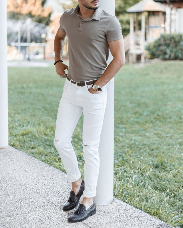 A man wearing grey colour polo t-shirt and white jeans