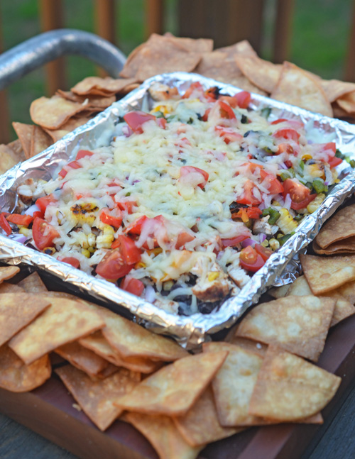 Loaded black bean dip with home made tortilla chips