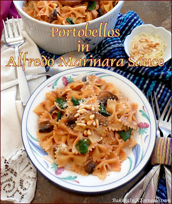 Portobellos in Alfredo Marinara Sauce is a meatless but hearty dinner. Portobellos are cooked in a creamy tomato sauce, served with spinach and bowtie pasta. | Recipe developed by www.BakingInATornado.com | #recipe #dinner