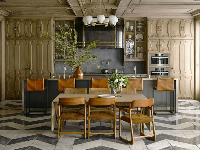 Dramatic open Ken Fulk kitchen fanciful wood cabinets leather bar stools chevron floor