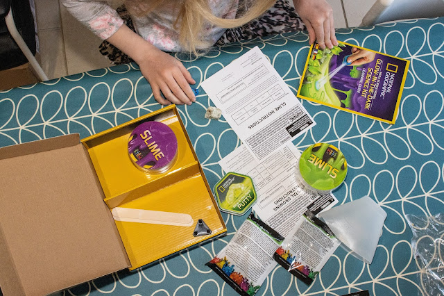 Reviewing the contents of the Glow in the dark science kit