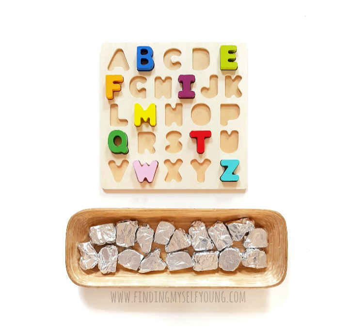 Alphabet puzzle pieces wrapped in alfoil