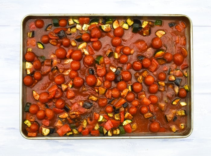How to make ratatouille pasta - step - 4 - stock, vinegar and tomato puree added to the veg